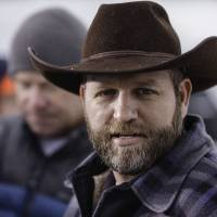 Ammon Bundy, leader of an armed anti-government militia, speaks at a news conference at the entrance to the Malheur National Wildlife Refuge Headquarters near Burns, Oregon, Tuesday. | AFP-JIJI