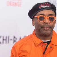 Spike Lee attends the Dec. 1 premiere of 'Chi-Raq' at the Ziegfeld Theatre in New York. Calls for a boycott of the Academy Awards are growing over the Oscars' second straight year of mostly white nominees, as Spike Lee and Jada Pinkett Smith each said Monday, they will not attend this year's ceremony. | CHARLES SYKES / INVISION / AP