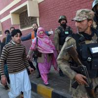 Pakistani soldiers rescue people from Bacha Khan University following an attack by militants in Charsadda, about 50 kilometers from Peshawar, on Jan. 20, 2016. | AFP-JIJI