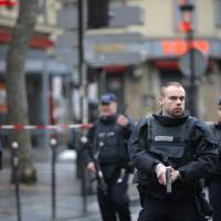 Man shot dead attacking police on Charlie Hebdo anniversary