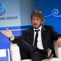 Sean Penn speaks during a forum with young entrepreneurs during the IMF and World Bank annual meeting in Lima in this Oct. 8 file photo. | AP