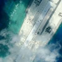 The northern end of the Subi Reef runway in the disputed South China Sea is seen Jan. 8. | CSIS / AMTI / DIGITALGLOBE / REUTERS