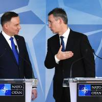 NATO Secretary-General Jens Stoltenberg (right) and Polish President Andrzej Duda hold a joint news conference after their bilateral meeting at NATO headquarters in Brussels on Jan. 18. | AFP-JIJI