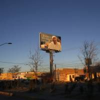 Late afternoon light falls on a giant billboard with an image of Pope Francis and a message saying 'Juarez is Love, We Are Ready' in Ciudad Juarez, Sunday. Once considered one of the most violent cities in the world, it has greatly improved and the violence mostly subsided, Ciudad Juarez has settled back in to the more common, but more stubborn problems facing Mexico's booming border cities: deep social inequality, poor wages and waves of migrants, either arriving from Central America or deported from the United States. | AP
