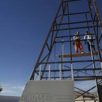 Inmates work on the construction of the bell tower of a prison chapel inside the state prison in Ciudad Juarez, Mexico, Sunday. | AP