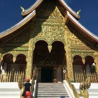 A tourist visits the Haw Pha Bang temple in the grounds of the Palace Museum in Luang Prabang, Laos. Luang Prabang weaves a never-never land spell on many a visitor with its tapestry of French colonial villas and Buddhist temples draped in a languid atmosphere. | AP