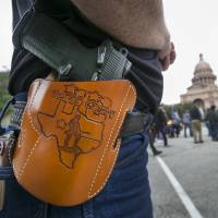 Terry Holcomb, the executive director of Texas Carry, walks to the state Capitol for a rally celebrating Texas becoming an open-carry state on Jan. 1. | AP