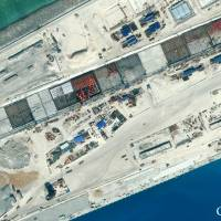 Chinese-built infrastructure is seen Jan. 8 on the northwest side of Subi Reef in the disputed South China Sea. | CSIS/AMTI/DIGITALGLOBE/REUTERS