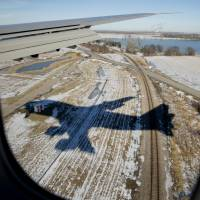 Air Force One, with President Barack Obama aboard, approaches Offutt Air Force Base in Bellevue, Nebraska, Wednesday.   AP