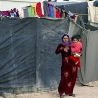 New UNHCR boss seeks mass resettlement of Syrians from border states as Germany closes door to North Africans