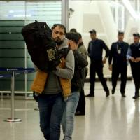 Iraqi refugees returning from Germany arrive at Irbil airport in Iraq Wednesday. | REUTERS