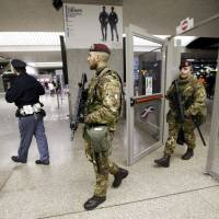 Armed officers patrol Termini Station, in Rome, Monday. Earlier Monday Italian authorities arrested a Moroccan citizen living in southern Italy suspected of seeking to become a foreign fighter for Islamic State. Italy's interior minister, Angelino Alfano, said that the arrest demonstrated the efficiency of new anti-terrorism measures adopted last spring. | AP