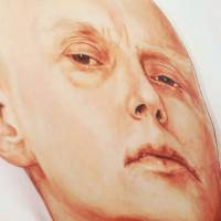 A visitor looks at a painting of Alexander Litvinenko in his London hospital bed by Dmitry Vrubel and Viktoria Timofeyeva at the Marat Guelman gallery in Moscow in May 2007. | AFP-JIJI