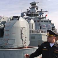 Capt. 1st Rank Stanislav Varik, the commander of the Russian navy destroyer Vice Admiral Kulakov, gestures as he speaks to reporters on board his ship in eastern Mediterranean on Thursday. | AP