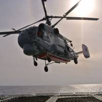 A Russian navy helicopter takes off from the deck of the Russian destroyer Vice Admiral Kulakov on patrol in the eastern Mediterranean on Thursday. | AP
