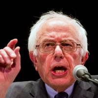 Sanders attacks Wall Street's business model of fraud, 'too big to fail' banks, Clinton