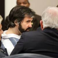 Michael Slager, a former North Charleston police officer, talks with his attorney before a hearing in Charleston, South Carolina, on Monday. | AP