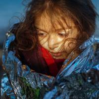 A migrant girl tries to warm herself as she disembarks from a boat on Lesbos Island, Greece, Monday. More than 850,000 people, most fleeing conflict in Syria and Afghanistan, entered Greece by sea in 2015, according to the UNHCR, and already in 2016, some 35,455 people have arrived despite plunging winter temperatures. | AP