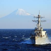 Mount Fuji is seen in the background of this official Facebook photo of the USS Curtis Wilbur. The guided-missile destroyer took part in the relief efforts following the March 2011 disasters and ensuing nuclear crisis. | U.S. NAVY