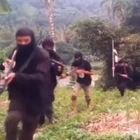 Gunmen train in this grab from an online video purportedly shot in the southern Philippines.