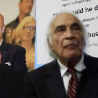 Tony Serra, an attorney for Raymond 'Shrimp Boy' Chow (pictured at left), listens to speakers at an April 2014 news conference in San Francisco. | AP