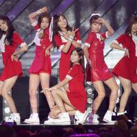 'Just Let Us Love' by the popular South Korean girl group Apink, shown performing in Gyeongju in October 2013, is one of the songs being broadcast across the demilitarized zone between North and South Korea starting Friday. | AP