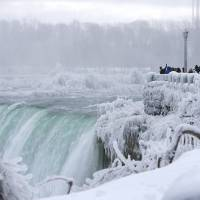 Tourist view Horseshoe Falls in Niagara Falls, Ontario, Saturday. | BLOOMBERG