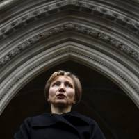 Marina Litvinenko, widow of murdered ex-KGB agent Alexander Litvinenko, reads a statement outside of the Royal Courts of Justice in London on Thursday. President Vladimir Putin probably approved a Russian intelligence operation to murder Litvinenko, a judge led-British inquiry into the 2006 killing in London concluded. | REUTERS