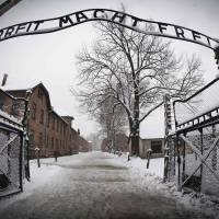 This January 2015 photo taken in Oswiecim, Poland, shows the entrance to the former Nazi concentration camp Auschwitz-Birkenau with the lettering 'Arbeit macht frei' ('Work makes you free') A 95-year-old former medic at the Auschwitz death camp will go on trial next month on at least 3,681 counts of accessory to murder, German authorities said Monday. | AFP-JIJI