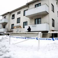 A police officer is seen outside a home for juvenile asylum seekers in Molndal in southwestern Sweden on Monday. A 22 year old female employee was killed in a knife attack at the center for migrant youths traveling alone. | ADAM IHSE / TT NEWS AGENCY / AFP-JIJI