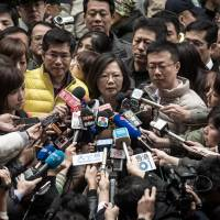 Democratic Progressive Party presidential candidate Tsai Ing-wen talks to the media after voting in New Taipei City on Saturday. | AFP-JIJI