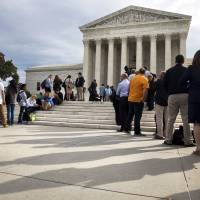 U.S. top court bars automatic life terms for crimes committed by teens