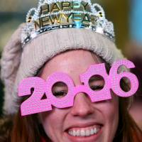 A woman awaits 2016 in Times Square in Manhattan Thursday. | REUTERS