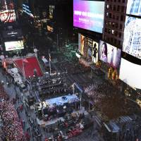Revelers gather at New York's Times Square during the New Year's Eve celebration, as seen from the New York Marriott Marquis hotel, Thursday. | AP