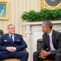 President Barack Obama speaks to U.S. Air Force Airman 1st Class Spencer Stone in the Oval Office of the White House in Washington in September. | AP