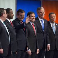 Presidential hopefuls (from left) Rand Paul, Chris Christie, Ben Carson, Ted Cruz, Marco Rubio, Jeb Bush and John Kasich arrive for the Republican candidates' debate in Des Moines, Iowa, on Thursday. | BLOOMBERG