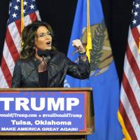 Former Republican vice presidential candidate Sarah Palin speaks to a crowd as she introduces Republican presidential candidate Donald Trump at a rally in Tulsa, Oklahoma, Wednesday. | AP