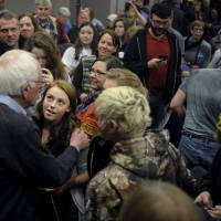 U.S. Democratic presidential candidate Bernie Sanders greets supporters at a town hall at Upper Iowa University in Fayette, Iowa, Sunday. | REUTERS