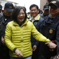 Taiwan's Democratic Progressive Party chairwoman and presidential candidate, Tsai Ing-wen, greets a supporter at a campaign rally in Taichung on Friday. | REUTERS