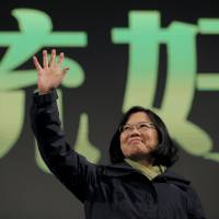 Tsai Ing-wen waves to supporters at her party's headquarters in Taipei on Saturday after her victory in Taiwan's presidential election. | REUTERS