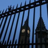 Big Ben in the Elizabeth Tower is seen through railings at Britain's Parliament buildings in Westminster in London, Monday. A proposal to ban Donald Trump from the United Kingdom because of his comment to ban Muslims from entering the United States drew a lively debate Monday in the British Parliament. | AP