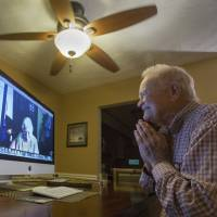 Norwood Thomas, 93, talks Nov. 6 with Joyce Morris via Skype from his home in Virginia Beach, Virginia. During World War II, Morris lived in England and was Joyce Durrant, the girlfriend of Thomas, a D-Day paratrooper with the Army's 101st Airborne Division. Morris now lives in Australia. | BILL TIERNAN / THE VIRGINIAN-PILOT VIA AP