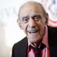 Actor Abe Vigoda smiles as he attends the Friars Club Roast of Betty White in New York in this file photo from May 16, 2012. Vigoda, an American actor best known for roles in 'The Godfather' and the 1970s sitcom 'Barney Miller,' died on Tuesday at the age of 94, after spending three decades jokingly refuting rumors of his demise. | REUTERS