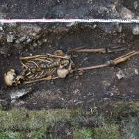 This undated handout picture from the Austrian Archaelogy Institute shows a skeleton of a man missing his left foot and ankle and having a prosthetic implant, in Hemmaberg, southern Austria. Archeologists believe it to be Europe's oldest prosthetic implant. | AFP / AUSTRIAN ARCHAELOGY INSTITUTE