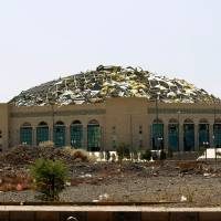 A sports hall is partially destroyed Tuesday by Saudi-led airstrikes in Sanaa. | AFP-JIJI