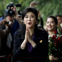 Ousted Thai Prime Minister Yingluck Shinawatra arrives the Supreme Court in Bangkok on Friday.   REUTERS