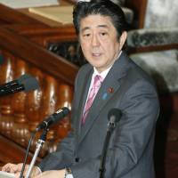 Abe stands by Amari but expects embattled minister to explain cash for favors allegation