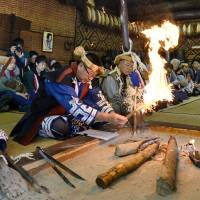 Ainu from across Hokkaido get together at the Ainu Museum in the town of Shiraoi on Nov. 1 for a harvest thanksgiving ceremony. | KYODO