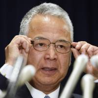 Economic and fiscal policy minister Akira Amari at Thursday's press conference in Tokyo.   KYODO