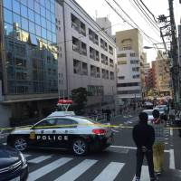 A photo provided by a bystander shows police sealing off a street outside The British School in Tokyo in Shibuya Ward on Thursday.